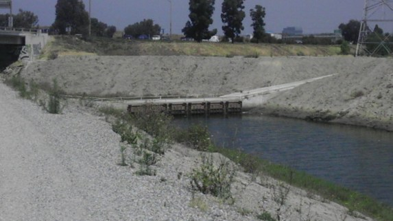 Thanks to funds collected by Metro's ExpressLanes, funding to convert this bridge and other parts of the Dominguez Channel will be converted into a bicycle and pedestrian path.and the service road that has now been funded to be converted into a similar path. This portion along the channel is currently closed. Carson and County Flood Control will work together to open it to the public for bicyclists and pedestrians. Photo: Lauren Grabowski
