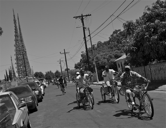 Members of the L.A. Real Rydas roll out from the Watts Towers. Sahra Sulaiman/Streetsblog LA