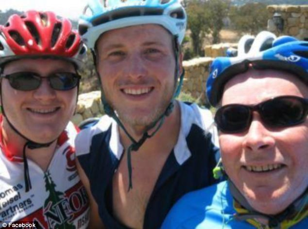 Olin is pictured in his cycling gear with sons Chris, left, and Geoff