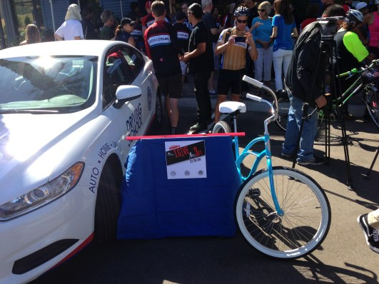 From this morning's #IGive3Ft press event. The 3-foot long pink bar demonstrates the three feet passing distance, though, legally, drivers shouldn't pass to the left of a bicycle. All photos by Joe Linton