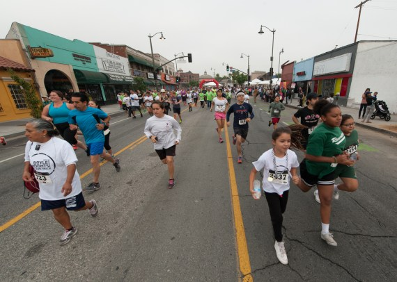 And they're off! Runners make their way down 1st St. in Boyle Heights. Photo: Eddie Ruvalcaba