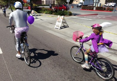 Daughter and dad dressed up at April's CicLAvia