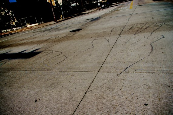 """Fingers painted on the street call out """"23."""" Sahra Sulaiman/Streetsblog L.A."""