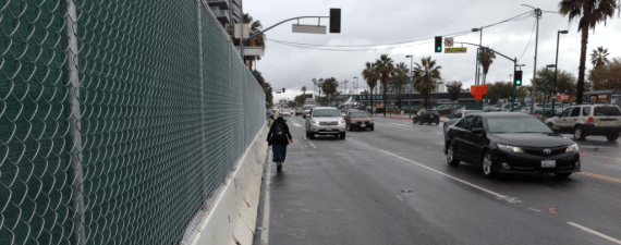 With the sidewalk closed, this pedestrian chose to walk in the street rather than cross to the other side of Lankershim.