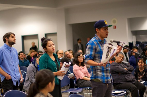 Irwin Plata speaks about the importance of cultural markers in communities while Stephanie Olwen awaits her turn to speak. Both are students at YouthBuild in Boyle Heights. Sahra Sulaiman/Streetsblog L.A.