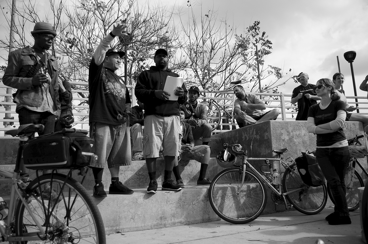 """Javier """"J.P."""" Partida speaks about the history of the Watts Towers and what they means to the community at the exploratory ride for a South L.A. CicLAvia. Sahra Sulaiman/Streetsblog L.A."""