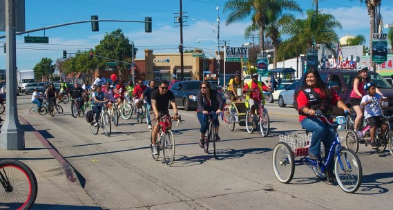 Riders roll into the South Gate community of South Los Angeles during the Ride4Love. Sahra Sulaiman/Streetsblog L.A.