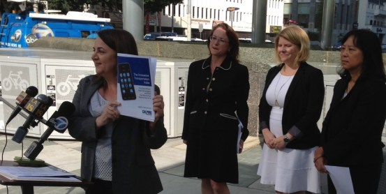 CALPIRG's Diane Forte (left) showcases The Innovative Transportation Index report at this morning's press event. Behind her are Hilary Norton, Seleta Reynolds, and Lindy Lee. Photo: Joe Linton/Streetsblog L.A.