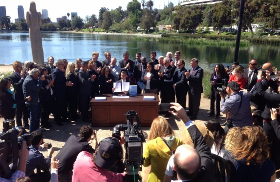 Mayor Garcetti (seated center) signs executive order enacting his new Sustainable City pLAn. Photo: Joe Linton/Streetsblog L.A.