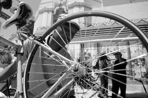 Ade Neff, founder of Ride On!, works on wheel. Sahra Sulaiman/Streetsblog L.A.