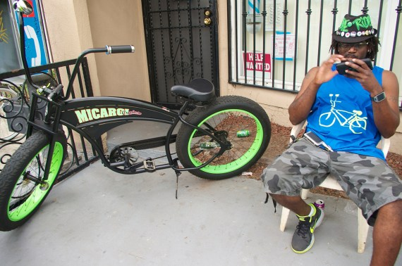 """Ervin """"EJ"""" Bromell and his bike relax outside the new co-op space. Sahra Sulaiman/Streetsblog L.A."""