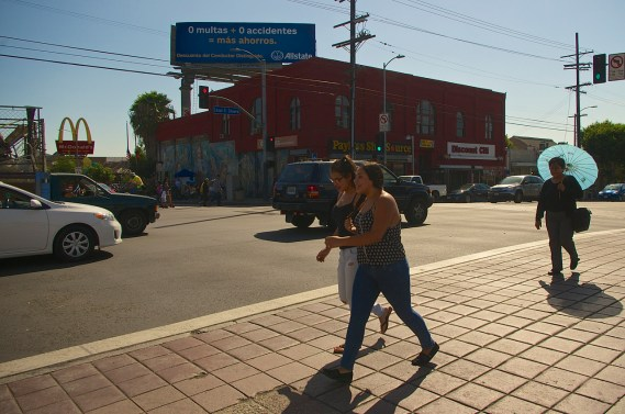 Pedestrians cross Soto along Cesar Chavez. Across the street, would-be passengers gather at the bus stop. Sahra Sulaiman/Streetsblog L.A.