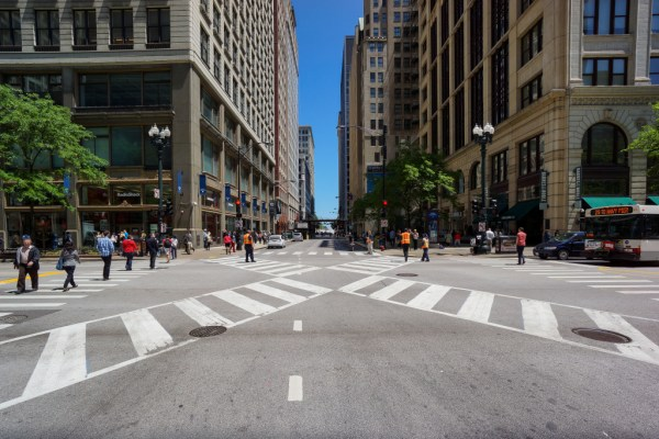 "Chicago's first pedestrian scramble, or ""Barnes Dance"", at the downtown intersection of Jackson Blvd. and State St. Pedestrians are allowed to cross all directions, including diagonally, every three light cycles. All vehicular turns have been prohibited to improve traffic flow. Photo: Chicago's first pedestrian scramble, or ""Barnes Dance"", at the downtown intersection of Jackson Blvd. and State St. Pedestrians are allowed to cross all directions, including diagonally, every three light cycles. All vehicular turns have been prohibited to improve traffic flow. KEVIN ZOLKIEWICZ/FLICKR via ##http://www.scpr.org/programs/airtalk/2014/11/03/40143/los-angeles-ponders-diagonal-crosswalks-what-are-t/##Airtalk/KPCC##"