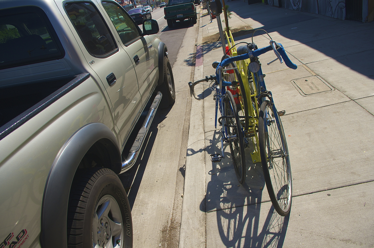 My own bike locked up to a butterfly rack (where another bike was already locked) presents an obstacle to someone looking to get in and out of passenger-side doors. Sahra Sulaiman/Streetsblog L.A.