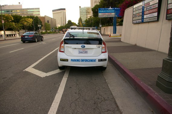 A parking enforcement vehicle occupies the southbound bike lane on Los Angeles St. in July. Sahra Sulaiman/Streetsblog L.A.