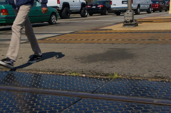 The uneven and raised asphalt around the UPRR tracks at Florence can present an obstacle to those trying to move wheeled things across the intersection. Sahra Sulaiman/Streetsblog L.A.