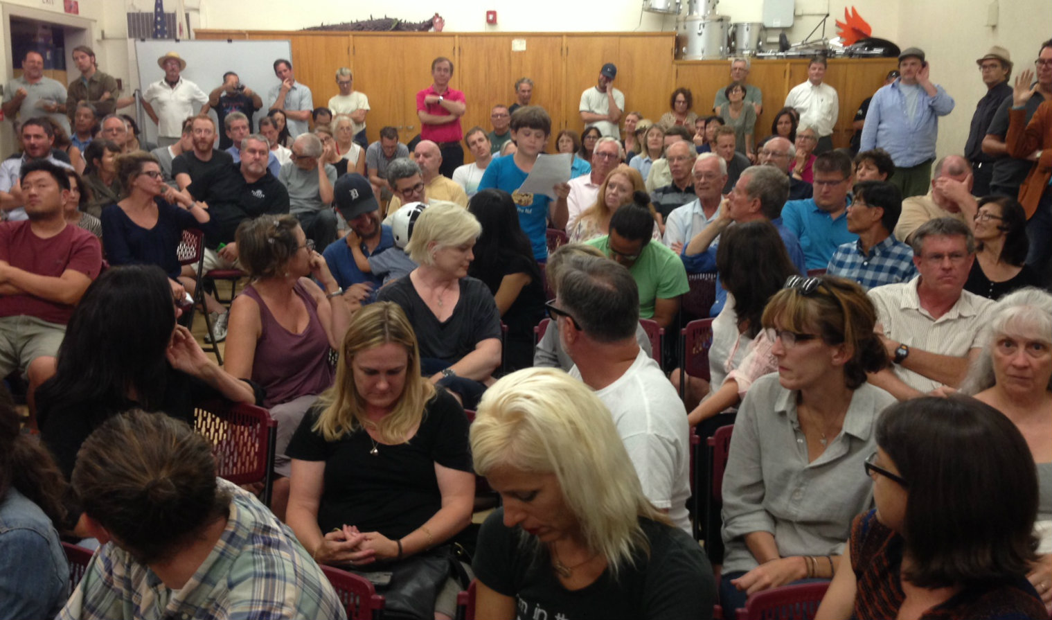 Matlock Grossman (center in blue shirt) reads his comments at the Rowena Avenue forum. Photo by Joe Linton/Streetsblog L.A.