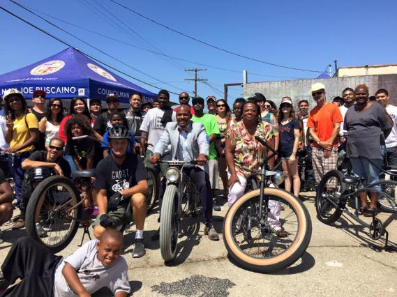 Supporters gather for a photo after touring the community. Photo courtesy of the East Side Riders.