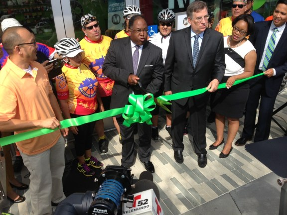 Metro chair Mark Ridley-Thomas cuts the ceremonial ribbon on Metro's El Monte bike hub. To his right are Board Vice Chair John Fasana, and Deputy CEO Stephanie Wiggins. All photos: Joe Linton/Streetsblog L.A.