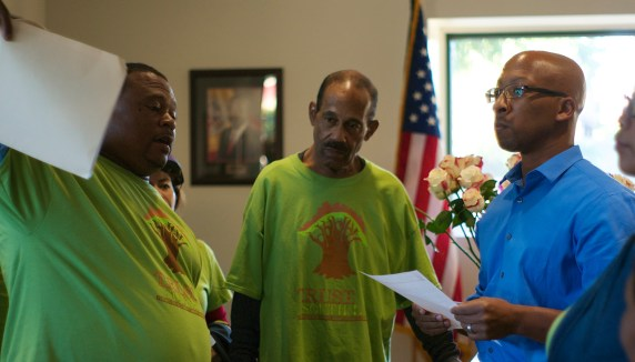 Residents hand their letter to James Westbrooks, District Director. Sahra Sulaiman/Streetsblog L.A.