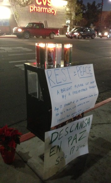 Signs at last night's vigil for Andres Perez. Photo: Joe Linton/Streetsblog L.A.
