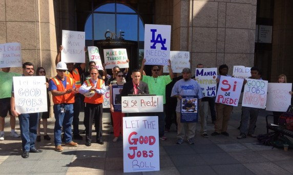 Jobs to Move America organizer Diego Janacua speaks at this morning's rally. Photo: Joe Linton/Streetsblog L.A.