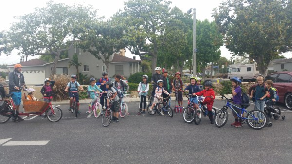 I presented to the kinders on Bike to School Day. Over half of them biked to school that day. Usually the total cyclists is one. This picture is from the Park and Bike event we hold before school for the commuter students to participate.