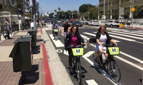 Deputy Mayor Barbara Romero and LADOT General Manager Seleta Reynolds take a celebratory ride in the Los Angeles Street protected bikeway. All photos by Joe Linton/Streetsblog L.A.
