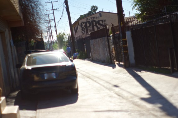 The Playboys (PBS), a prominent gang in the area, leave their stamp on the side of a house in one of the alleys designated for a makeover. Sahra Sulaiman/Streetsblog L.A.