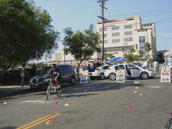 A youth tries out the obstacle course set up by Multicultural Communities for Mobility. Sahra Sulaiman/Streetsblog L.A.