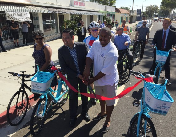 Garcia and Richardson cut the ribbon on the Artesia protected bike lanes