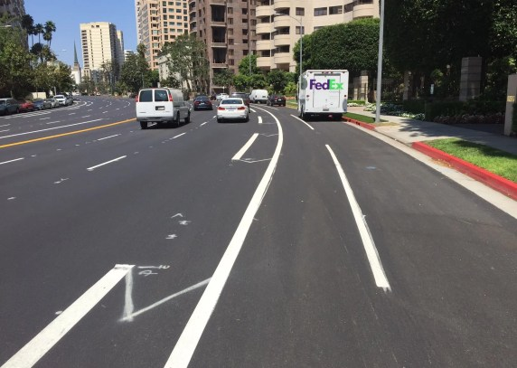 Buffered bike lane preliminary markings on Wilshire in Westwood