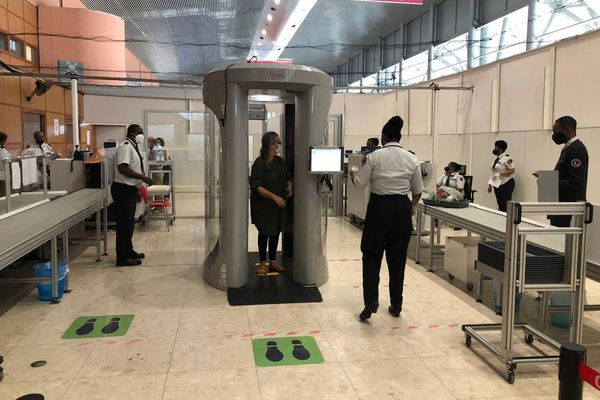 The targeted traveler goes through the body scanner at Felix Eboué airport in French Guiana