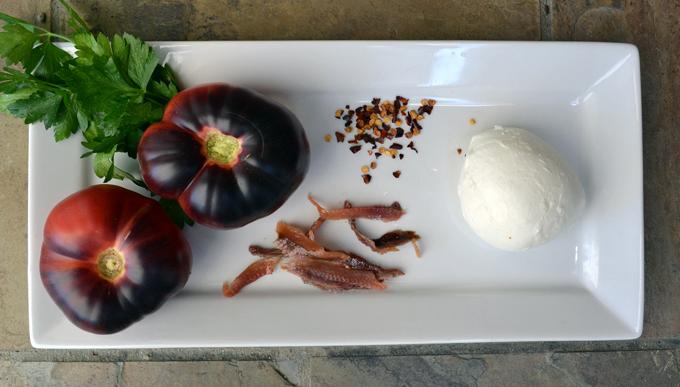 The essential ingredients for Bruschetta with Tomato, Mozzarella & Anchovy | labellasorella.com