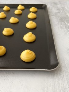 Choux Pastry (Pâte à Choux) piped on baking sheet