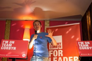 LONDON, ENGLAND - AUGUST 10: Owen Jones, political activist and author, announces policy ideas for young people at a rally in support of Jeremy Corbyn's campaign for the Labour Party leadership at All Star Lanes on August 10, 2015 in London, England. Candidates for the Labour party leadership are continuing to campaign with voting set to take place on the 14th of August and the new leader elected by the 12th of September. Whilst Jeremy Corbyn leads in the polls some members of the party have called to postpone the election in fear that it has been infiltrated by supporters of other parties. (Photo by Rob Stothard/Getty Images)