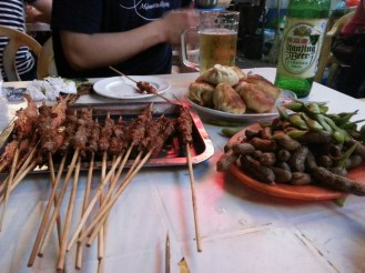lamb and shrimp skewers, dimsum, and edamame