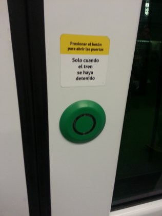 Interesante! These buttons allow passengers to open the monorail doors.