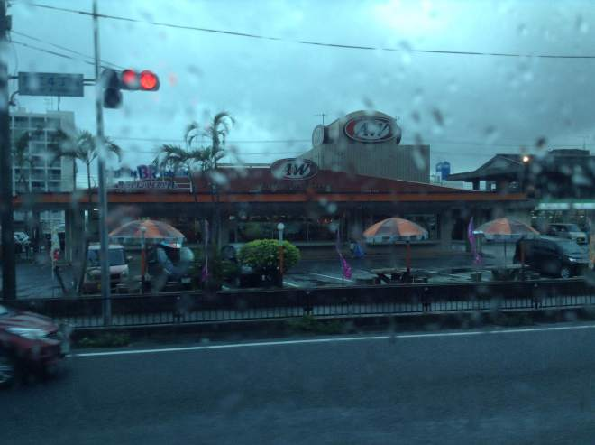 View from the bus of an A&W restaurant on a rainy day
