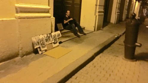A Cuban artist sells his work on the streets late at night. I bought one of his works for 10CUCs.