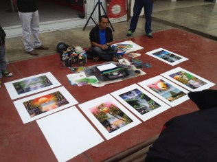 a street artist works in the street