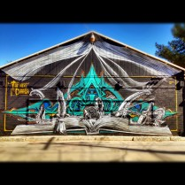 The next chapter mural painted on the back of an old garage door.