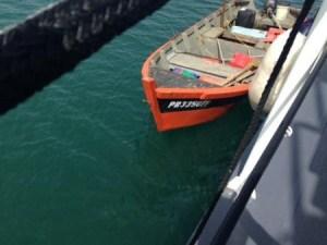 Bote en el que salieron de pesca Ríos y Nieves. (Foto Ricardo Castrodad del Coast Guard.)