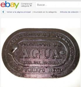 """Tapa de contador de la AAA a la venta en """"eBay""""."""