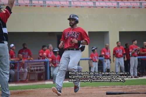 AA 4-Elvin Delgado (Cardenales) marca primera carrera del juego wm