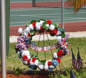 The Veteran's Club placed a memorial wreath at the base of the flag pole