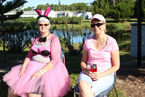 Fairy Princess June Reed (L) and Deb Poe greet La Casa residents as they lineup to have their cars washed.