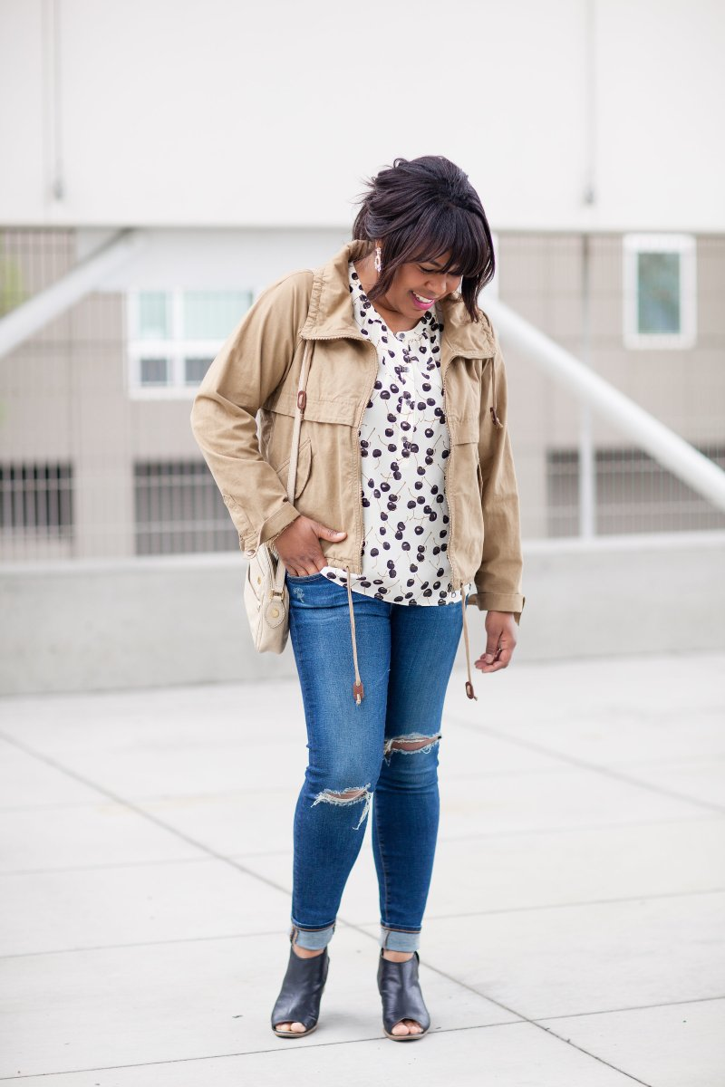 Flutter sleeve blouse, anorak jacket (military jacket), and distressed jeans.