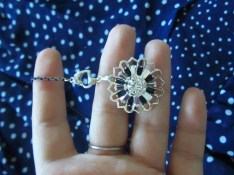 """A necklace is started with the filigree compass charm/pendant and a navy blue 10"""" enameled brass base strand."""