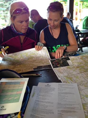 Kim and her team mate strategizing the course.
